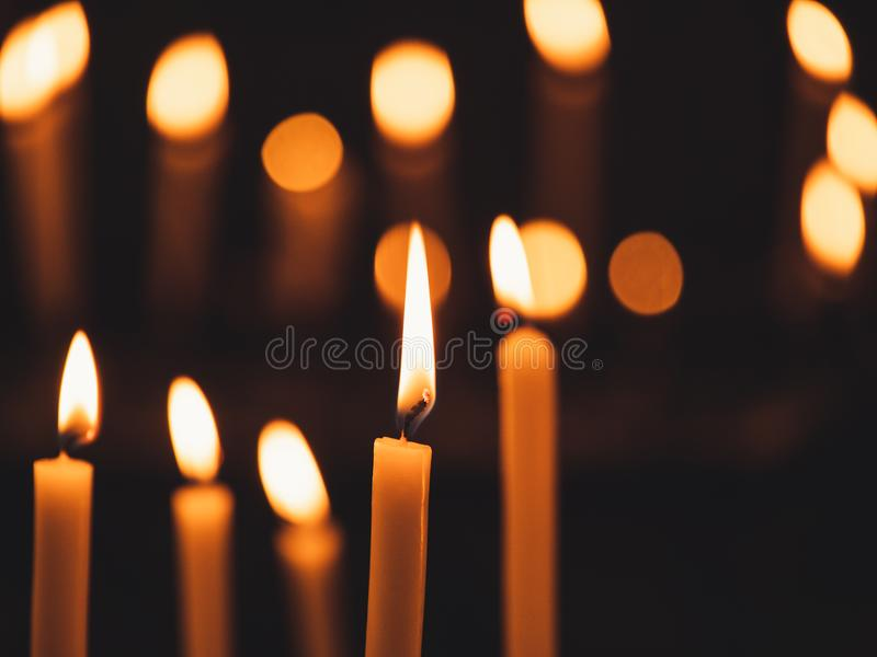 Image of many burning candles with shallow depth of field royalty free stock photo
