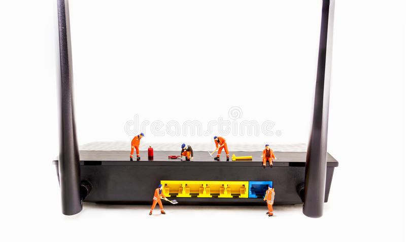 Image of mini figure dolls engineer fix internet wifi router is royalty free stock photography