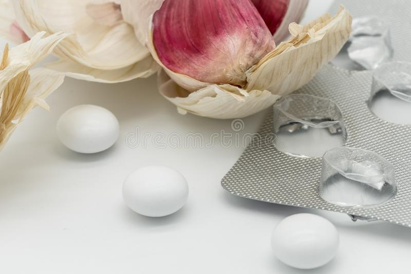 image of a mock-up of Garlic supplements together with a died Garlic bulb and clove. stock photography