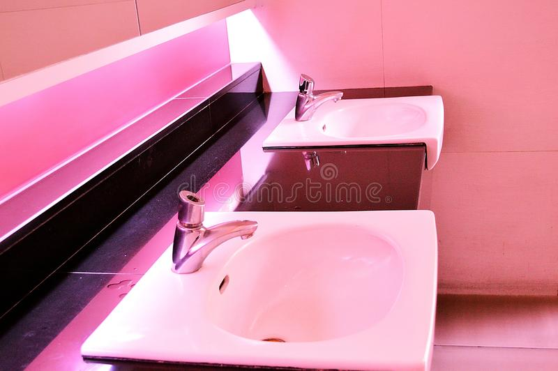 Image of modern toilet interior. Pink concept stock image