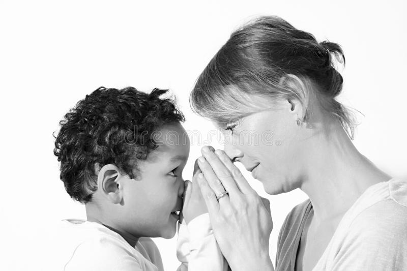 Mum and son praying together royalty free stock photos