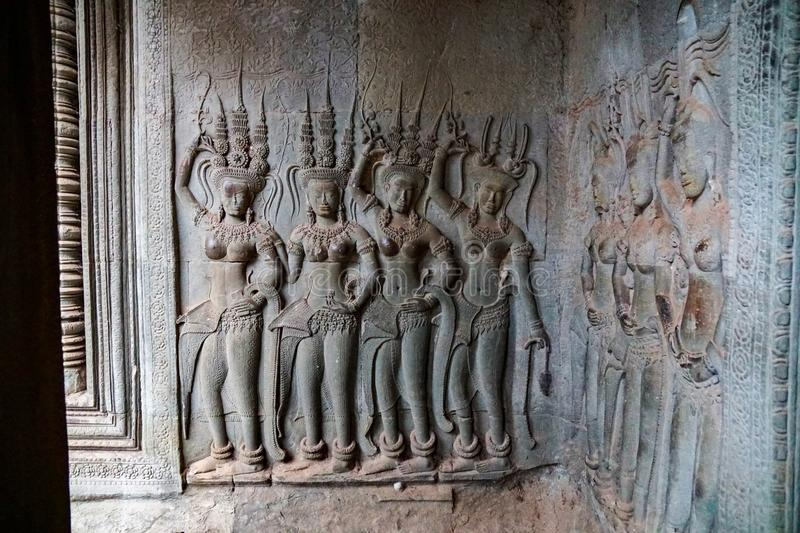 Image of naked women, concubines, on the wall of Angkor Wat. Siem Reap, CAMBODIA - July 17, 2019: stone image of naked women, concubines, on the wall of Angkor stock image