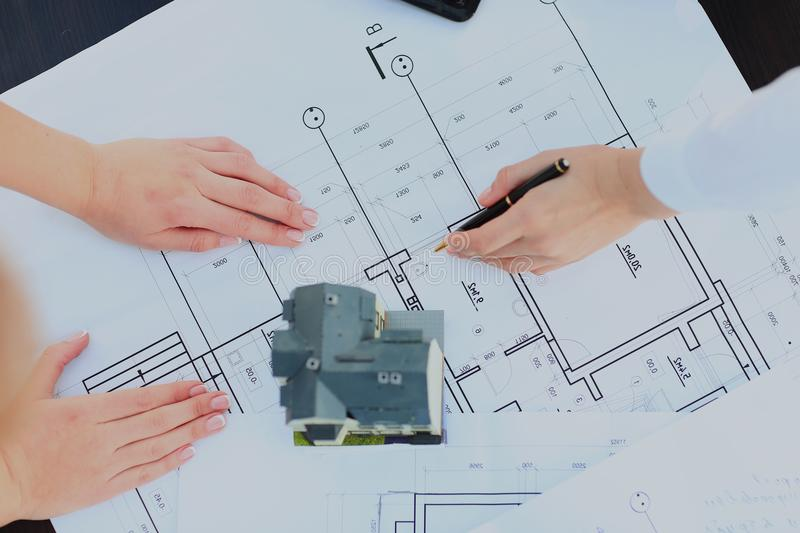 Image of new model house on architecture blueprint plan at desk. Image of new model house on architecture blueprint plan at desk stock photos