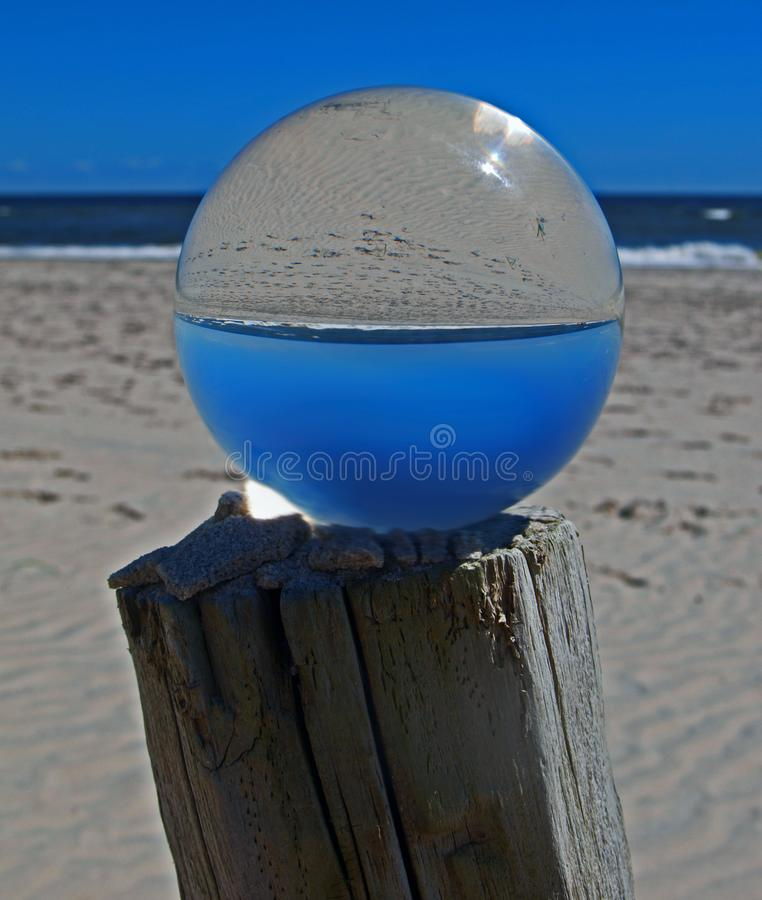 Ocean Image Inverted in Lens Ball stock photos
