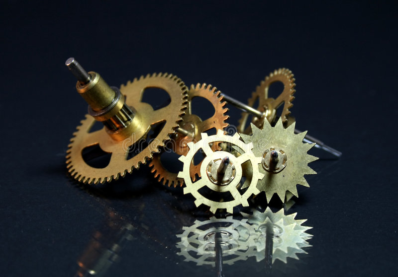 Image of a old clock's parts. Spare parts stock photography