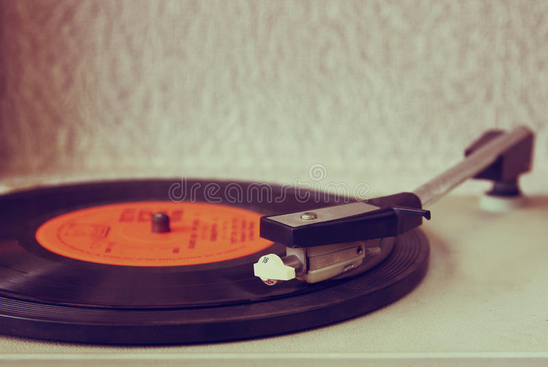 Image of old record player, image is retro filtered . selective focus.  stock photo