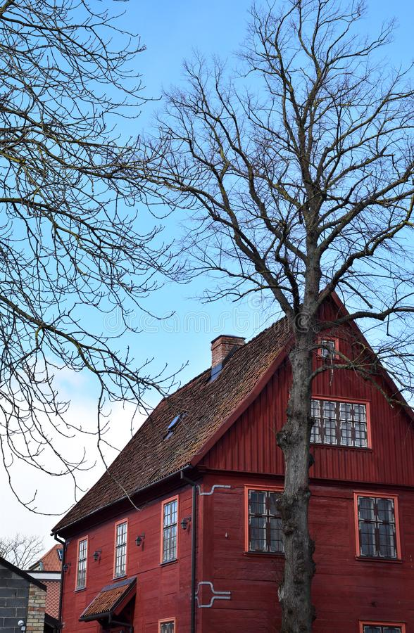 Image of an old red wooden house in Latvia. royalty free stock photography