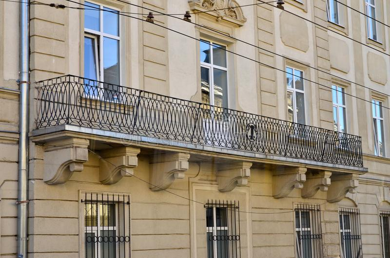 Image of an old wrought-iron frame on the balcony of a multi-storey building in Lviv, Ukraine stock images