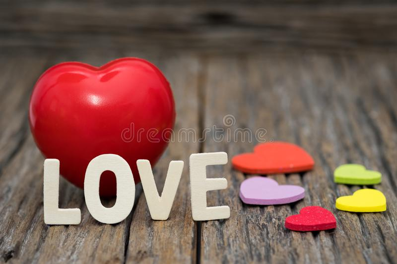 Image-One Heart and love word on wooden background. Copy space Valentines day concept stock photos