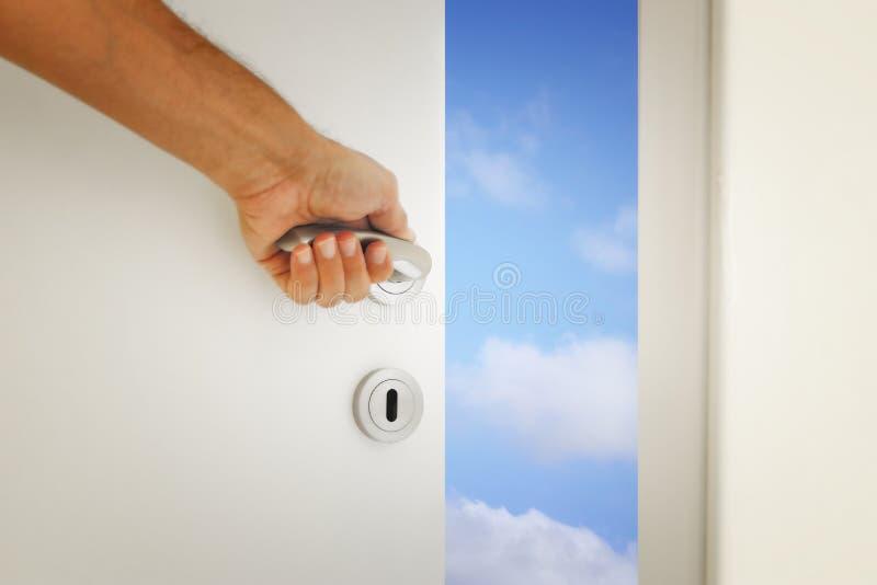 image of open door to the blue sky stock photos