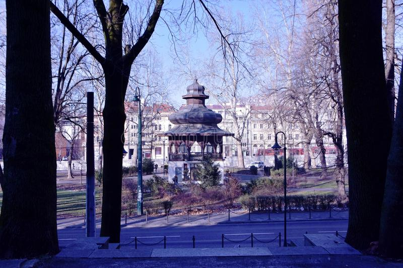 Image of oriental looking structure building in the city park with view of trees and street. Scenery view of oriental looking structure building in the city park royalty free stock photos