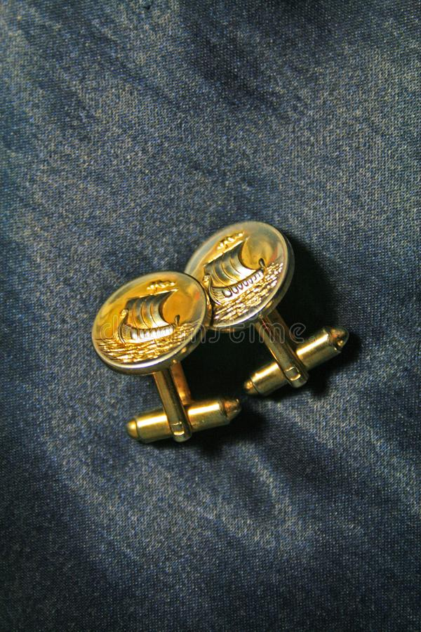 DECORATIVE GOLD COLOURED CUFF LINKS stock photography