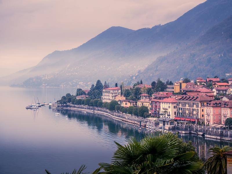 Image of a panorama view of cannero riviera at lake maggiore in italy on a foggy cloudy day. In spring stock photography