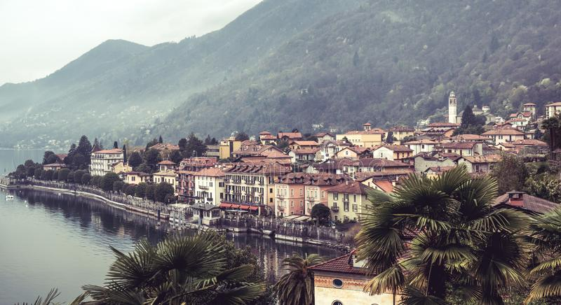 Image of a panorama view of cannero riviera at lake maggiore in italy on a foggy cloudy day. In spring royalty free stock image