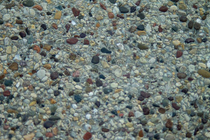 Image of pebbles on concrete. royalty free stock image