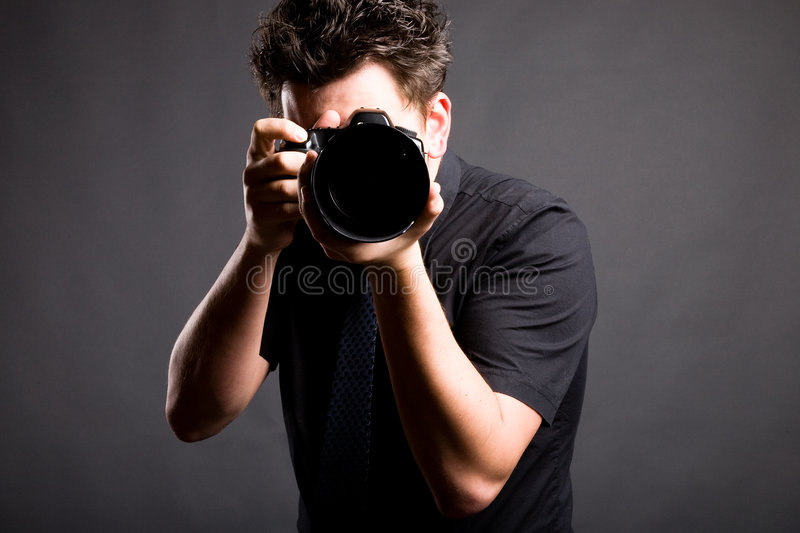 Image of photographer in black shirt stock photos