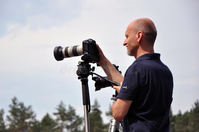 The image of a photographer with a tripod stock photo
