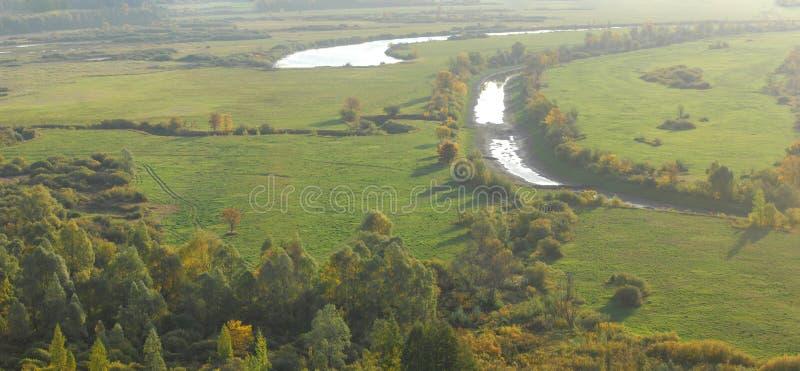 The image is 6000 by 3300 pixels. Autumn landscape. The flood me. Adows stock photo