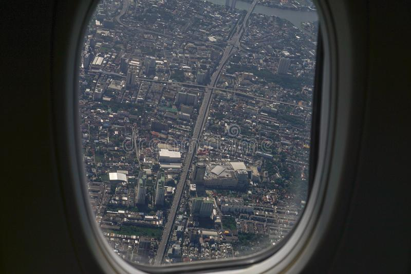 Image of plane window View of the village from the bird& x27;s eye vi royalty free stock photography