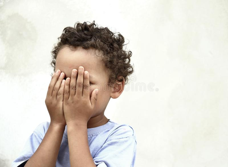 Poverty boy crying. Image of a poverty boy crying with white background royalty free stock photos