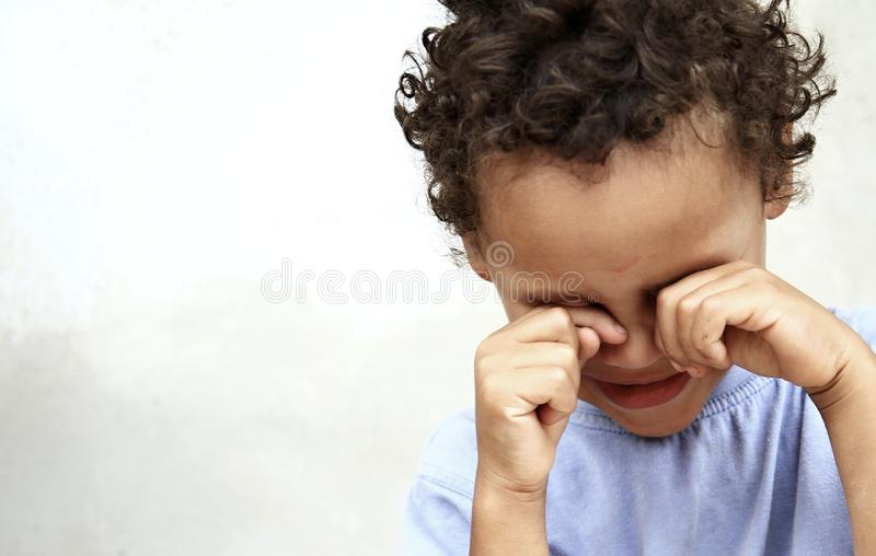 Poverty boy crying royalty free stock images