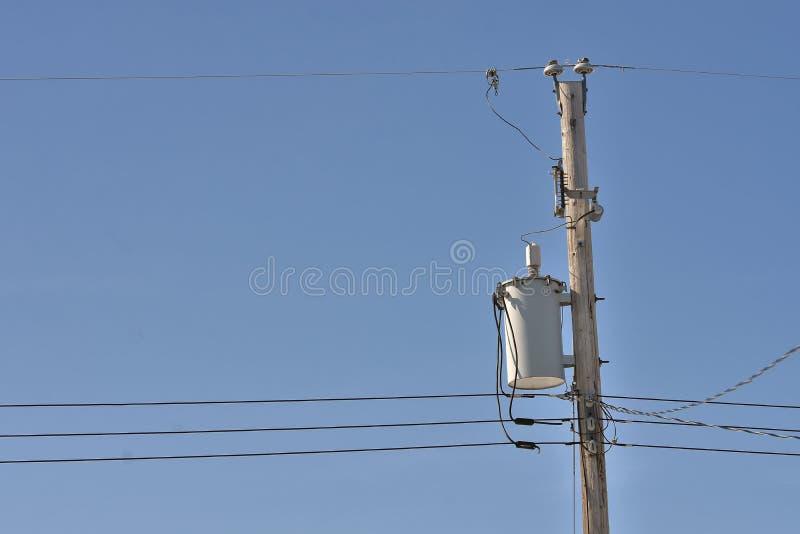 Power Tranformer. An image of a power transformer on a wooden power pole stock photos