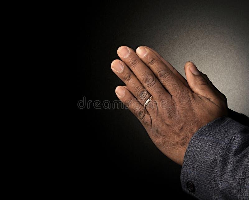 Praying hands symbolizing love of god. Image of praying hands clenched together symbolizing love of god stock photo