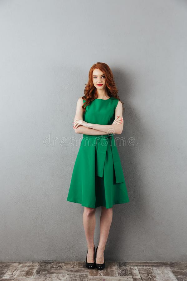 Pretty redhead young lady in green dress royalty free stock images