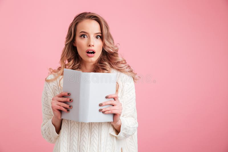 Pretty shocked lady reading book stock images
