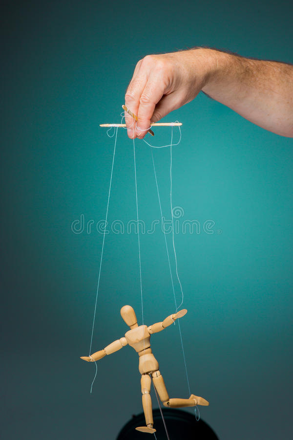 Image puppet in the hands of the puppeteer royalty free stock image
