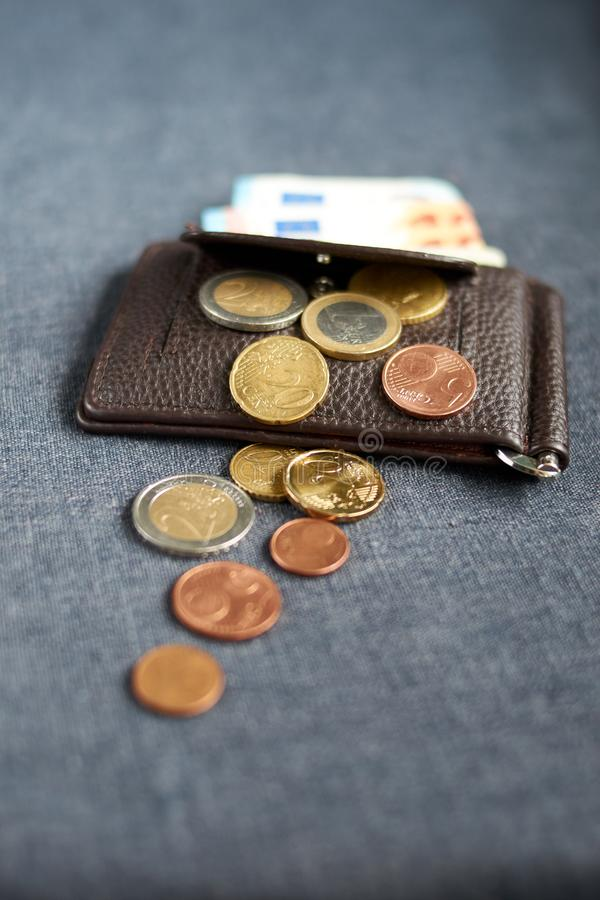An image of a purse with money. On gray background royalty free stock photo