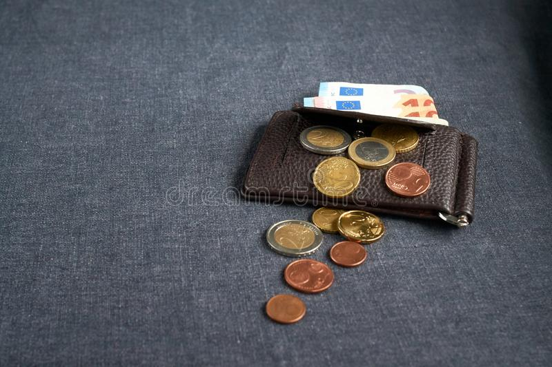An image of a purse with money. On gray background stock photography