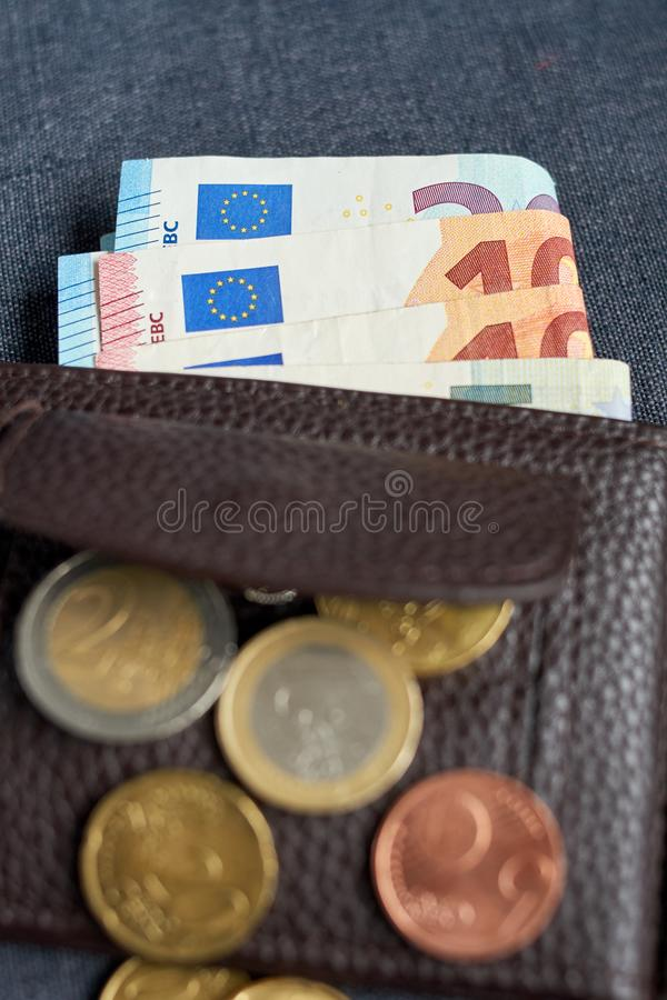 An image of a purse with money. On gray background stock images