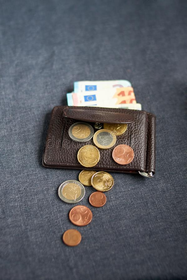 An image of a purse with money. On gray background royalty free stock photos