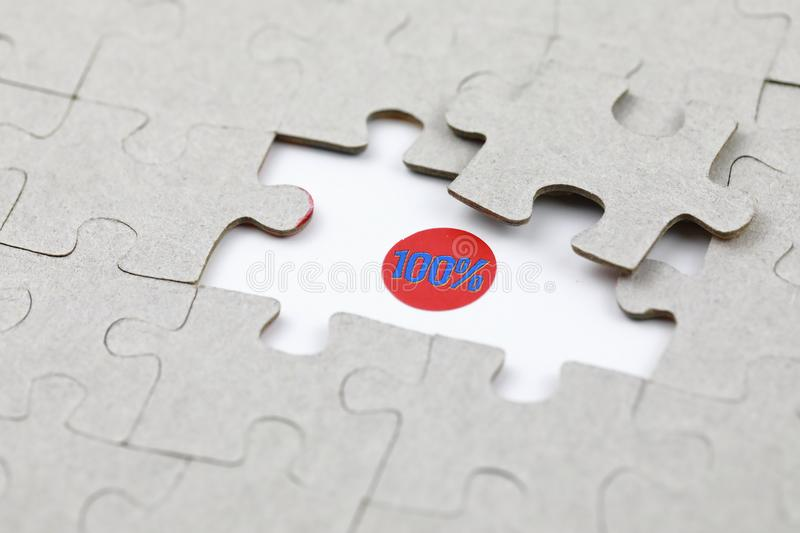 Image of Puzzle piece with Hundred percent. Business, assemble stock photo