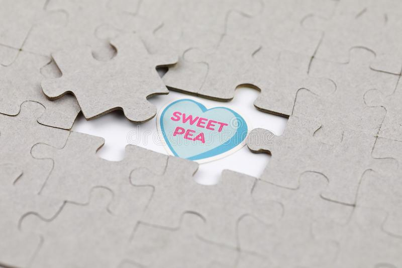 Image of Puzzle piece with sweet pea . Business, assemble. Image of Puzzle piece with sweet pea , Last piece of jigsaw puzzle , Vector transparent puzzle on stock photo