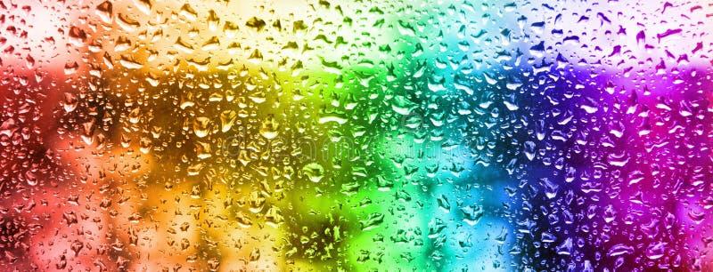 image of rain drops on glass stock illustration
