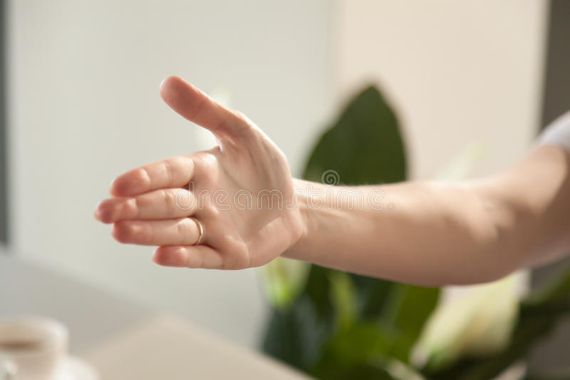 Image of reached out for handshake womans hand stock photos