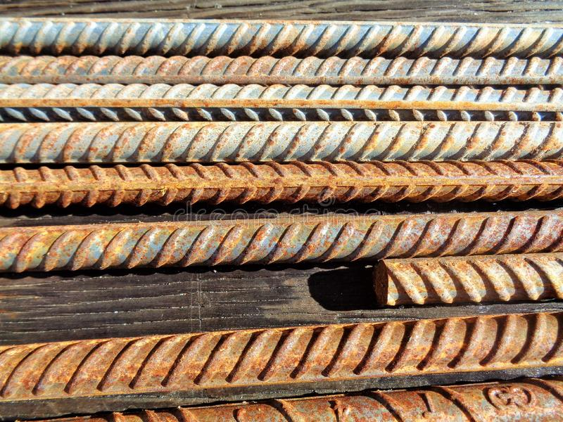 Parallel Rebar Rods on a Wooden Table royalty free stock photos