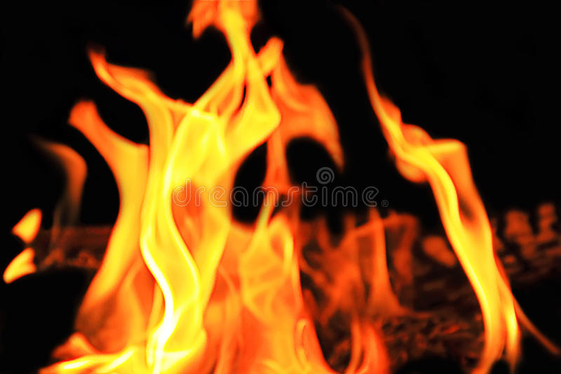 Red flame on the black background stock image