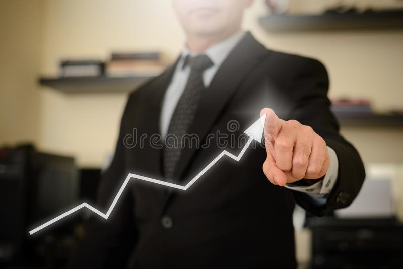 Business man showing success chart royalty free stock photos