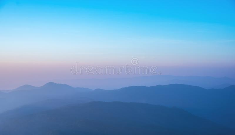 row of mountain on morning time. stock images