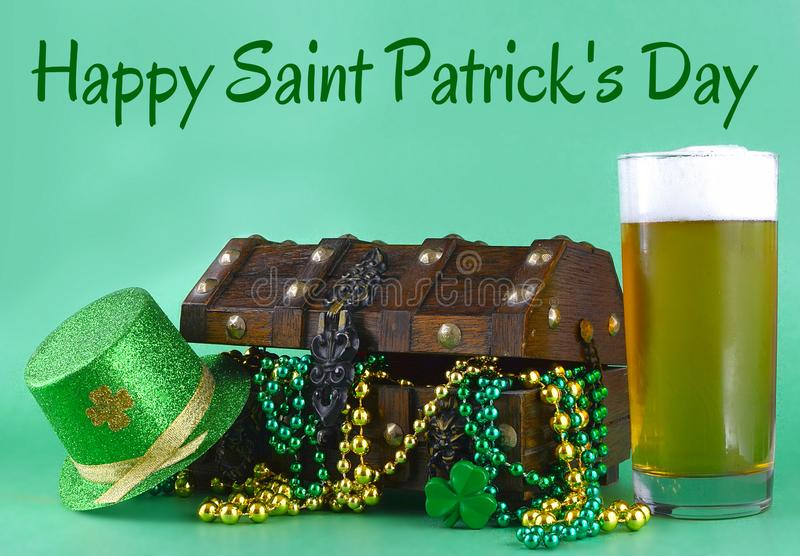 Image for Saint Patrick`s Day on March 17th. Treasure chest to symbolize luck and wealth. A glass of beer and green hat added. stock photography