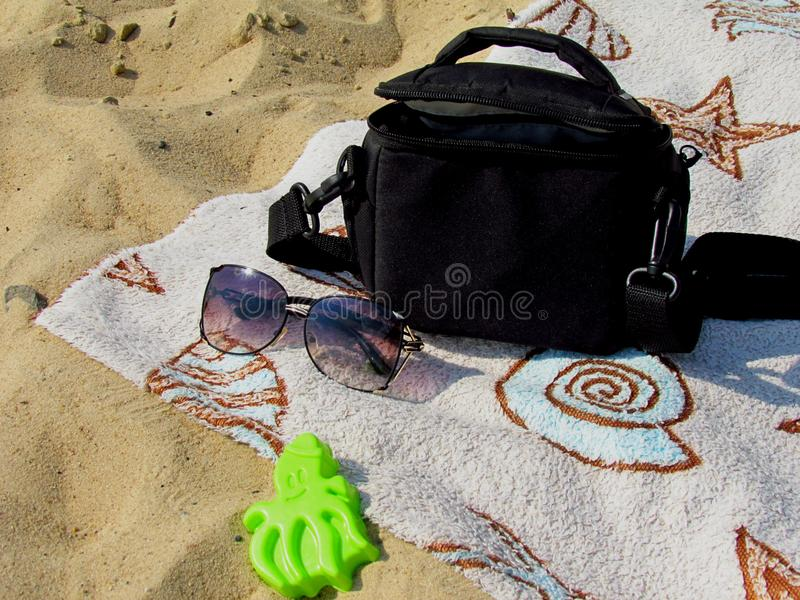 Attributes of a summer holiday on a sandy beach on a sunny afternoon royalty free stock photo