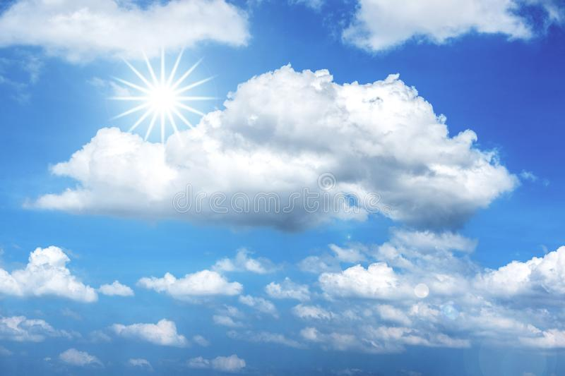 Star-shaped Sun and Fluffy White Clouds in Blue Sky for Background. Image of scattered puffy white clouds and star-shaped sun in the blue sky background stock image