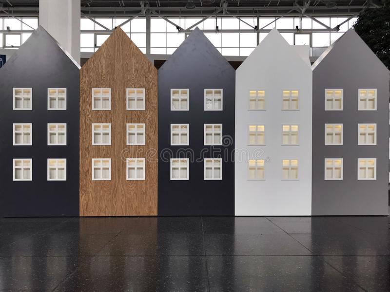 Image of several houses cardboard houses with windows. five houses different color. Five Dutch houses in a row royalty free stock image