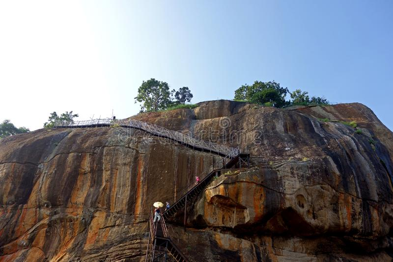 Tourists Descend the High Sigiriya Rock royalty free stock photo