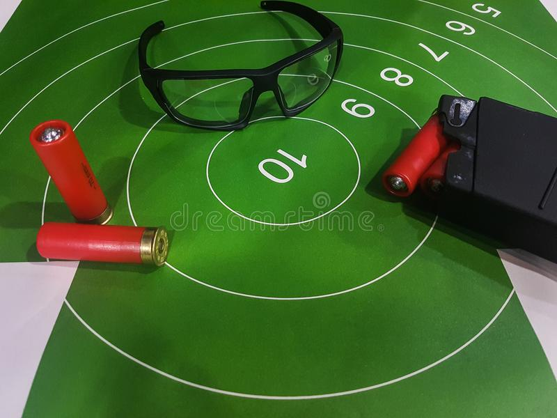 Image of shooting gallery with target, glasses, gun royalty free stock photography