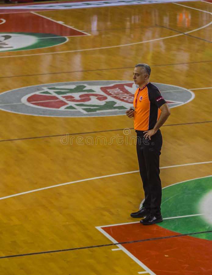 Basketball Head Referee. Image showing the head referee Zafer Yılmaz before the basketball game begins in Izmir, Turkey on October 8th, 2017 stock image