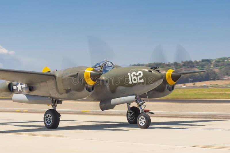 Lockheed P-38 Lighting. Image showing Lockheed P-38 Lighting Skidoo taxiing at  Camarillo Airport in California royalty free stock photography